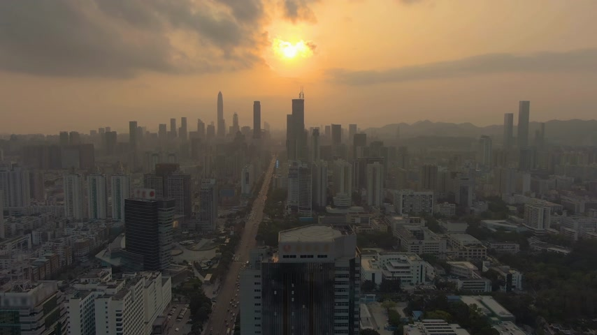ascend : Shenzhen Urban Cityscape at Sunset. China. Aerial View. Drone Flies Sideways and Upwards