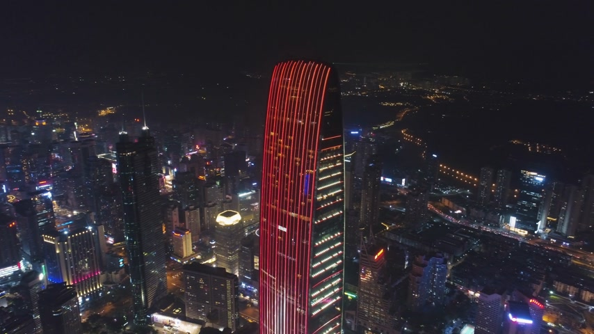 Шэньчжэнь : SHENZHEN, CHINA - MARCH 28, 2019: KK100 Skyscraper and Cityscape at Night. Aerial View. Drone is Orbiting