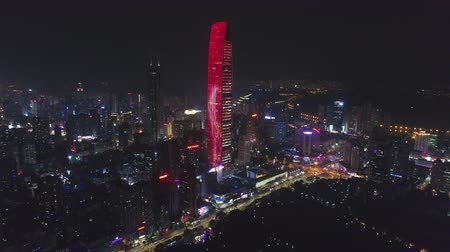 Шэньчжэнь : SHENZHEN, CHINA - MARCH 28, 2019: Kingkey Finance Tower Skyscraper and Cityscape at Night. Aerial View. Drone Flies Forward, Tilt Up. Reveal Shot Стоковые видеозаписи