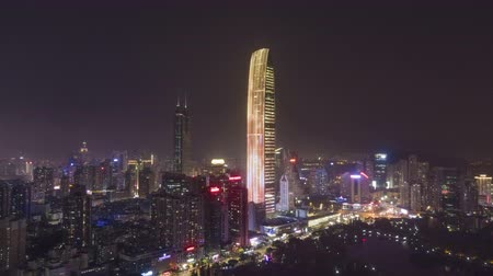 Шэньчжэнь : SHENZHEN, CHINA - MARCH 28, 2019: KK100 Skyscraper and Cityscape at Night. Aerial Hyper Lapse, Time Lapse