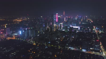 Шэньчжэнь : Shenzhen City at Night. Futian District. China. Aerial View. Drone Flies Sideways and Upwards