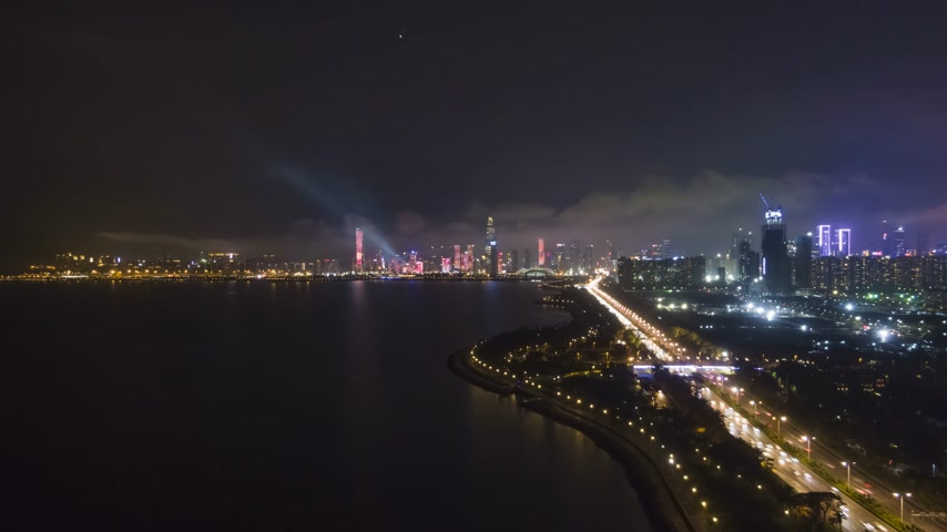 Шэньчжэнь : SHENZHEN, CHINA - MARCH 29, 2019: Nanshan District and Shenzhen Bay at Night. Aerial Hyper Lapse, Time Lapse. Drone Flies Forward, Tilt Up. Guangdong Стоковые видеозаписи