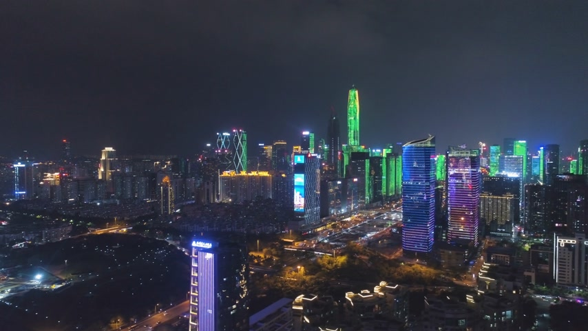 Шэньчжэнь : SHENZHEN, CHINA - MARCH 30, 2019: Urban Skyline and Light Show. Futian District. Aerial View. Reveal Shot. Drone Flies Sideways and Upwards
