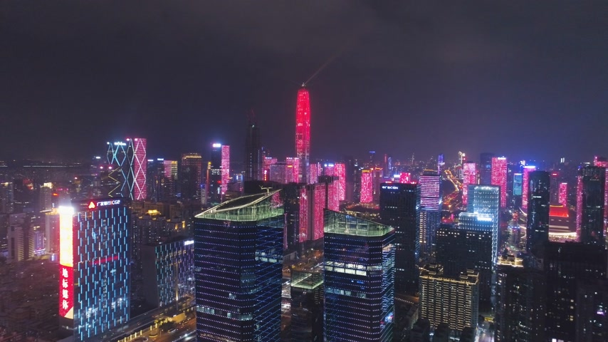Шэньчжэнь : SHENZHEN, CHINA - MARCH 30, 2019: Urban City and Light Show. Futian District. Aerial View. Reveal Shot. Drone Flies Forward