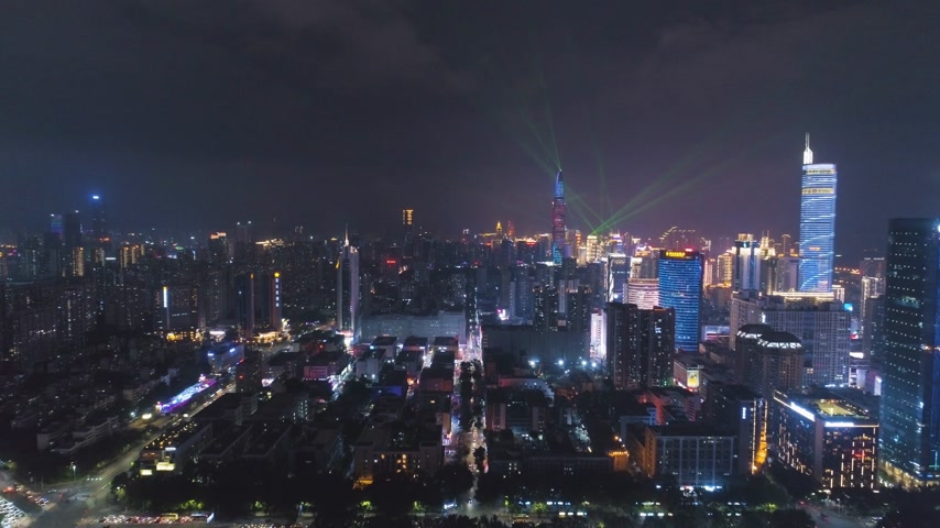 Шэньчжэнь : SHENZHEN, CHINA - MARCH 30, 2019: Illuminated Urban Cityscape at Night During Light Show. Futian and Luohu District. Guangdong. Aerial View. Drone Flies Forward and Upwards Стоковые видеозаписи