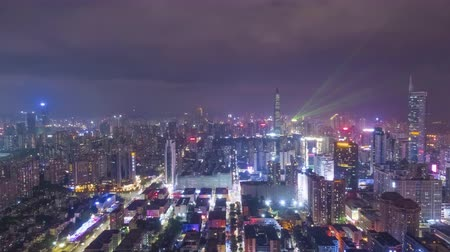 Шэньчжэнь : Shenzhen City at Night. Futian and Luohu District. Guangdong, China. Aerial Hyper Lapse, Time Lapse. Drone Flies Forward and Upwards