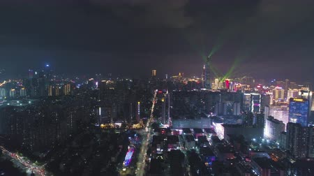 downwards : Illuminated Shenzhen Urban Cityscape at Night. Futian and Luohu District. Guangdong, China. Drone Flies Sideways and Downwards