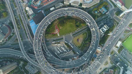 nanpu : Circular Nanpu Road Intersection. Traffic Circle. Shanghai, China. Aerial Vertical Top-Down View. Drone Hovers and Rotates. Establishing Shot