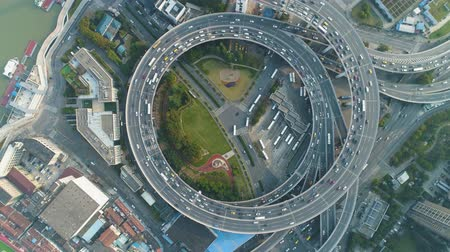 nanpu : Circular Elevated Nanpu Road Intersection. Shanghai, China. Aerial Vertical Top-Down View. Drone Flies Downwards and Rotates. Establishing Shot