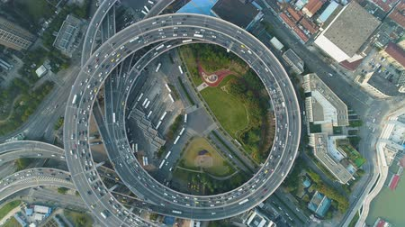 nanpu : Elevated Circle Nanpu Road Junction. Shanghai, China. Aerial Vertical Top-Down View. Drone Flies Upwards and Rotates. Reveal Shot