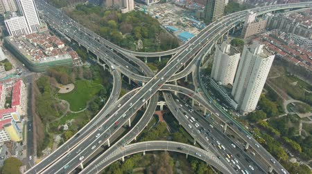 establishing shot : Complex Road Junction at Sunny Day. Shanghai, China. Aerial View. Drone is Orbiting
