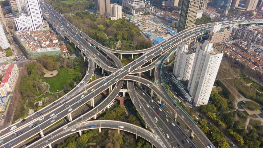 establishing shot : YanAn Complex Road Overpass at Sunny Day. Shanghai, China. Aerial Hyper Lapse, Time Lapse. Drone is Orbiting