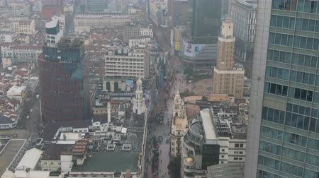 nanjing road : People at Nanjing Road. Pedestrian Street in Huangpu District. Shanghai City, China. Aerial View. Drone Flies Backwards. Stock Footage