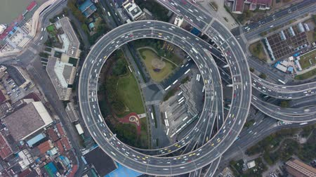 nanpu : Circular Nanpu Road Junction. Traffic Circle. Shanghai, China. Aerial Vertical Top-Down Hyper Lapse, Time Lapse. Drone Hovers and Rotates. Establishing Shot