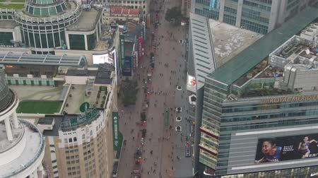 tilt : Nanjing Road. Pedestrian Street in Huangpu District. Shanghai City, China. Aerial View. Drone Flies Downwards, Tilt Up. Stock Footage