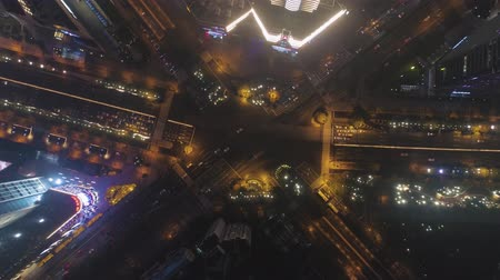 downwards : Complex Crossroad in Shanghai, China at Night. Aerial Vertical Top-Down View. Drone Rotates and Flying Downwards