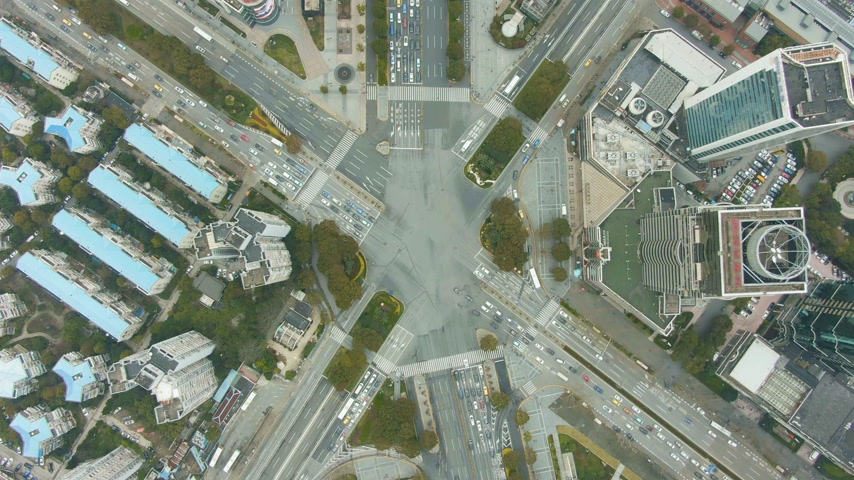 crossing road : Complex Road Crossing in Shanghai, China. Aerial Vertical Top-Down View. Drone is Hovering Stock Footage