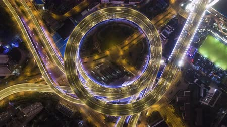 interscambio : Illuminated Circular Nanpu Road Overpass at Night. Traffic Circle. Shanghai, China. Aerial Vertical Top-Down Time Lapse. Drone Hovering
