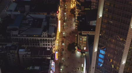 nanjing road : People at Nanjing Road at Night. Pedestrian Street in Huangpu District. Shanghai City, China. Aerial View. Drone Flies Forward.