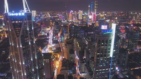 huangpu river : SHANGHAI, CHINA - MARCH 20, 2018: Shimao International Plaza and Lujiazui Skyline at Night. Aerial View. Drone Flies Forward, Tilt Up.