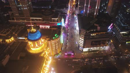 nanjing road : SHANGHAI, CHINA - MARCH 20, 2018: People at Nanjing Road at Night. Pedestrian Street in Huangpu District. Aerial View. Drone Flies Sideways.