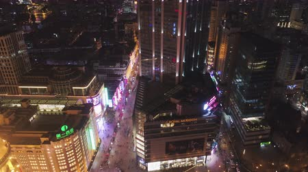 nanjing road : SHANGHAI, CHINA - MARCH 20, 2018: Nanjing Road and Lujiazui Skyline at Night. Aerial View. Drone Flies Sideways, Tilt Up.