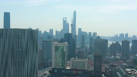 downwards : Shanghai City. Urban Lujiazui Cityscape at Sunny Day. China. Aerial View. Drone Flies Downwards