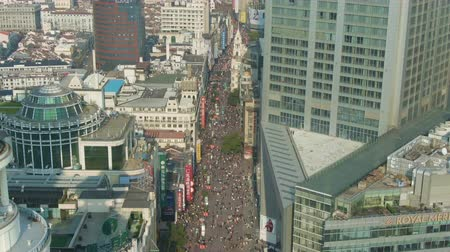 tilt : SHANGHAI, CHINA - MARCH 20, 2018: Nanjing Road. Pedestrian Street in Huangpu District. People Crowd. Aerial View. Drone Flies Downwards, Tilt Up.