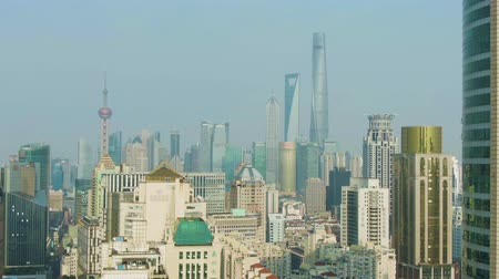 downwards : Shanghai City. Huangpu and Lujiazui District Cityscape at Clear Day. China. Aerial View. Drone Flies Backwards and Downwards. Medium Shot