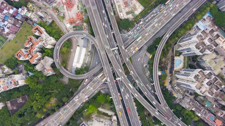 passagem elevada : Complex Highway Interchange in Guangzhou in Day, China. Aerial Vertical Top-Down Hyper Lapse, Time Lapse. Car Traffic. Drone Rotation