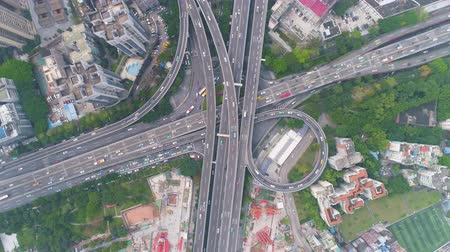 downwards : Complex Highway Junction in Guangzhou in Day, China. Aerial Vertical Top-Down View. Car Traffic. Drone Rotates and Flies Downwards