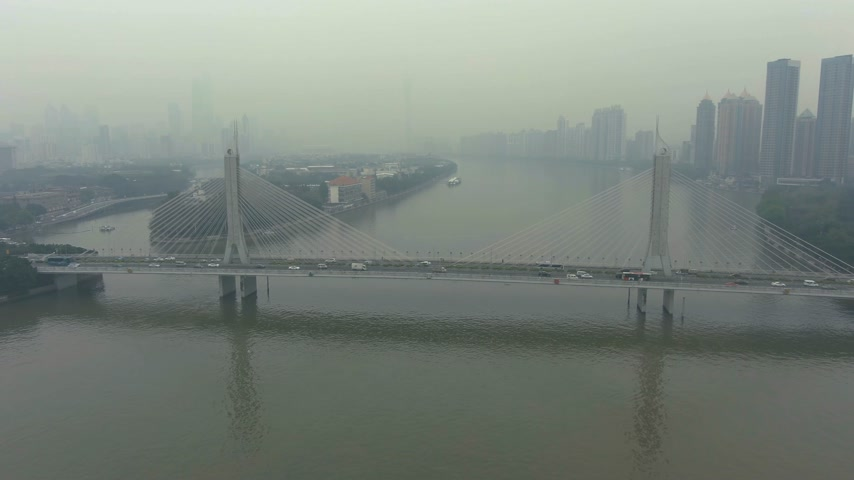 gyöngyszem : Bridge in Guangzhou in Smog, Car Traffic and Cityscape. Guangdong, China. Aerial View. Drone Flies Forward