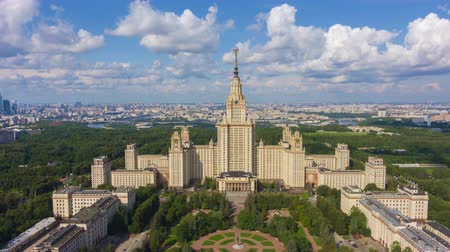 templomtorony : Moscow State University and Skyline at Sunny Day. Blue Sky with Clouds. Russia. Aerial Hyper Lapse, Time Lapse. Drone Flies Upwards