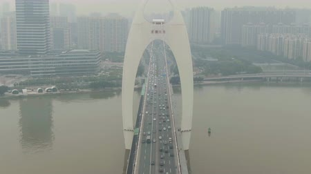 downwards : Liede Bridge on Pearl River. Guangzhou City in Smog, China. Aerial View. Drone Flies Downwards, Tilt Up. Crane Shot Stock Footage