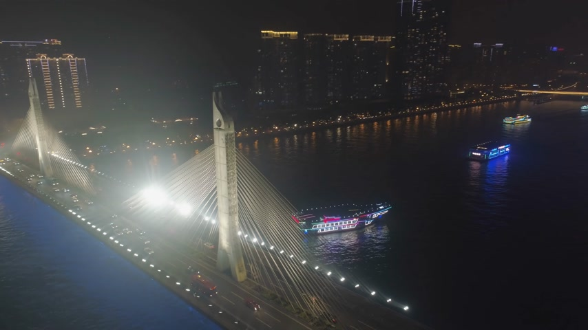 ascend : Bridge in Guangzhou City, Car Traffic at Night. Guangdong, China. Aerial View. Drone is Orbiting, Flies Upwards Stock Footage