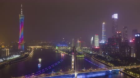 ascend : Liede Bridge and Guangzhou Cityscape at Night. Aerial Hyper Lapse, Time Lapse. Drone Flies Backwards and Upwards