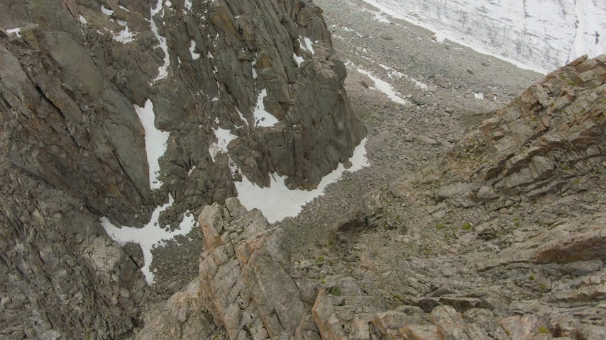 orbiting : Mountain Couloir. Aerial View. Drone is Orbiting Stock Footage
