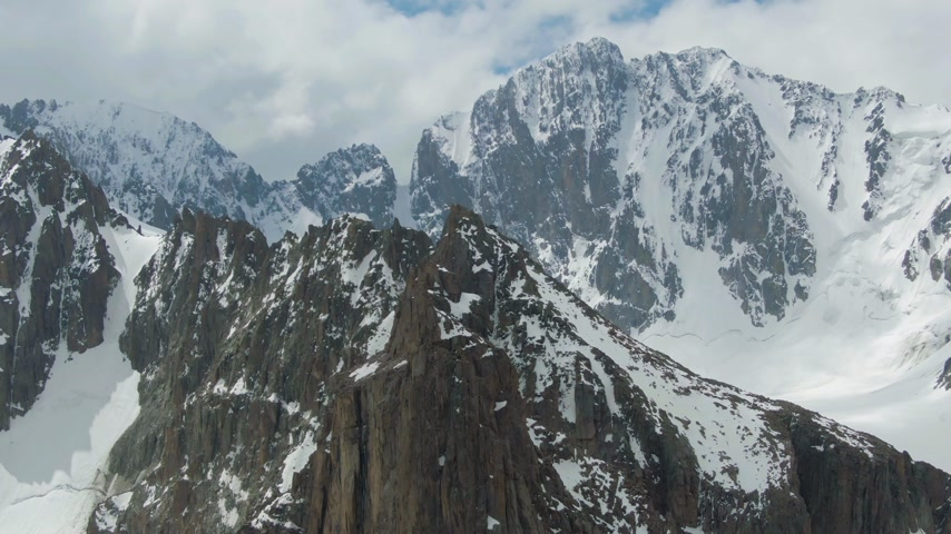 ascend : Tian Shan Snow-Capped Mountains. Drone is Orbiting Counterclockwise Stock Footage