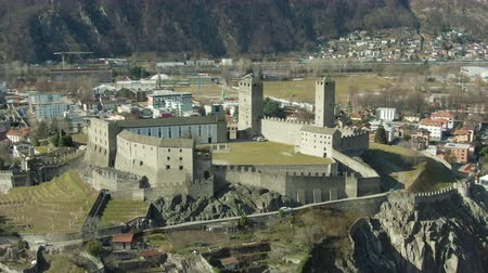 downwards : Castelgrande Castle. Bellinzona, Ticino, Switzerland. Aerial View. Swiss Alps Drone is Orbiting Medium Shot