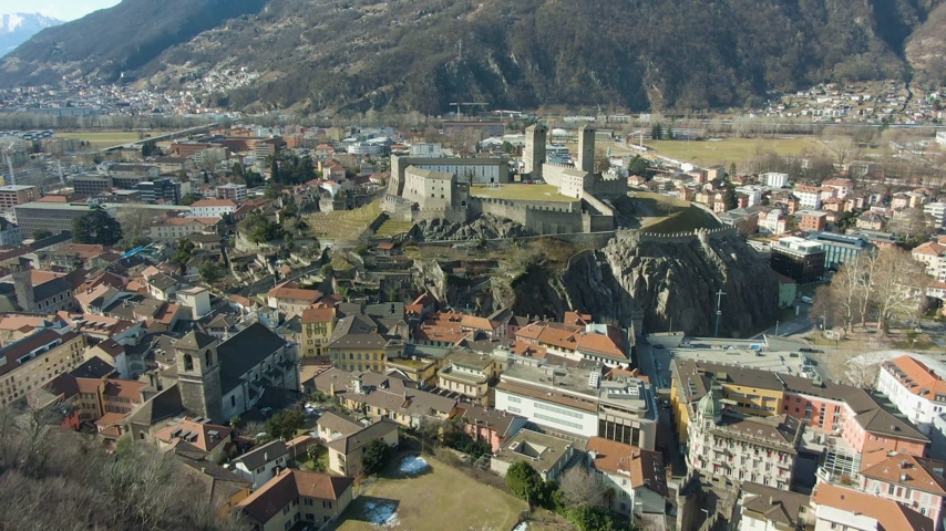 tilt : Castelgrande Castle. Bellinzona, Ticino, Switzerland. Swiss Alps. Aerial View. Drone Flies Forward Tilt Up Wide Shot