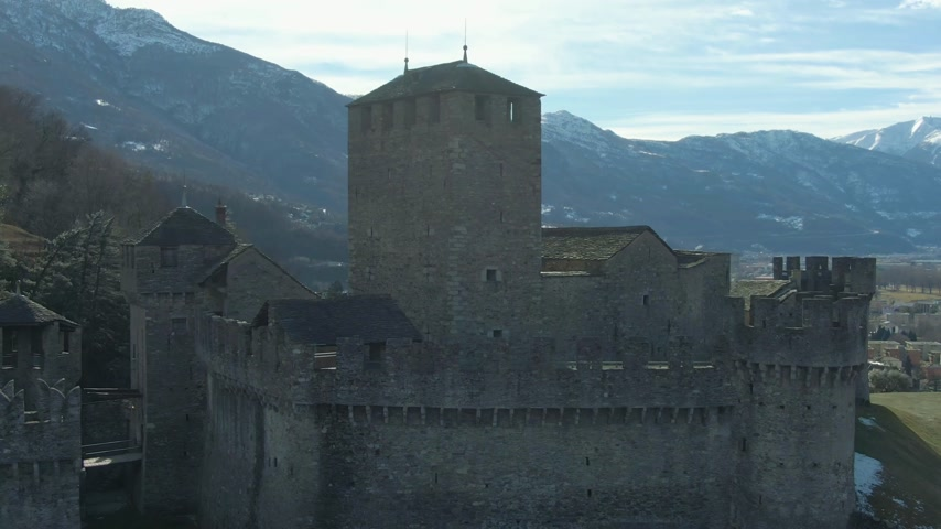 fortress : Montebello Castle. Bellinzona, Ticino, Switzerland. Swiss Alps. Aerial View. Drone Flies Upwards Tilt Down Medium Shot
