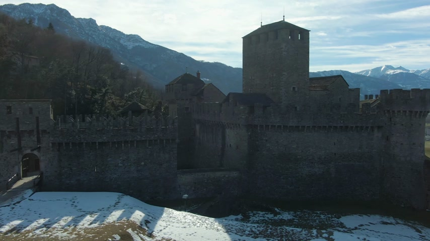 upward : Montebello Castle. Bellinzona, Ticino, Switzerland. Swiss Alps. Aerial View. Drone Flies Sideways and Upwards Wide Shot Stock Footage