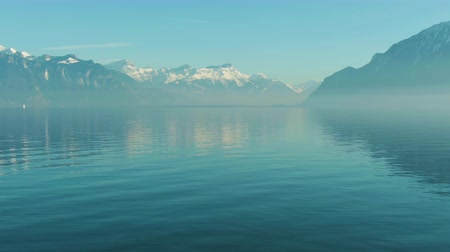 tampado : Lake Geneva and Snow-Capped Mountains. Switzerland. Aerial View. Drone Flies Backwards