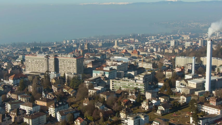 emelkedő : Lausanne City and Lake Geneva. Vaud, Switzerland. Aerial View. Drone Flies Sideways and Upwards Stock mozgókép
