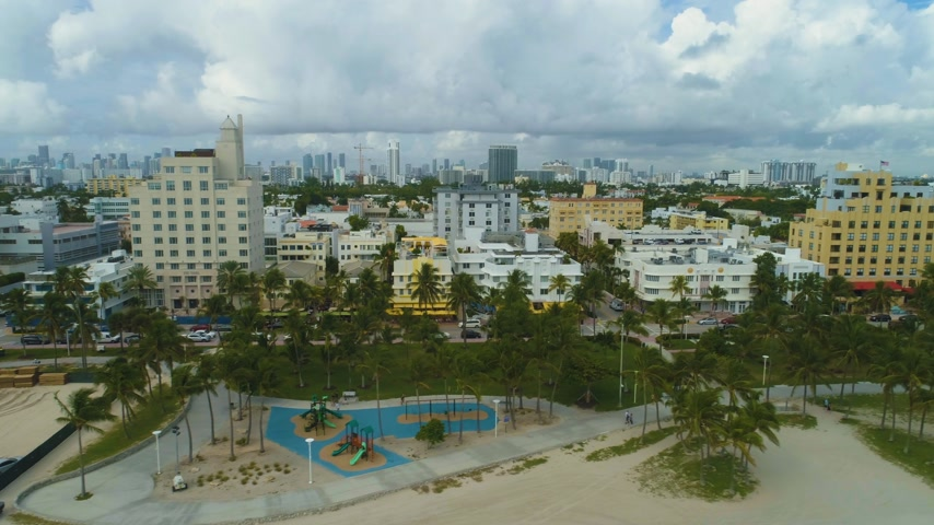 oldalt : Miami Beach and Miami Downtown on Cloudy Day. Urban Cityscape. Aerial View. United States of America Stock mozgókép