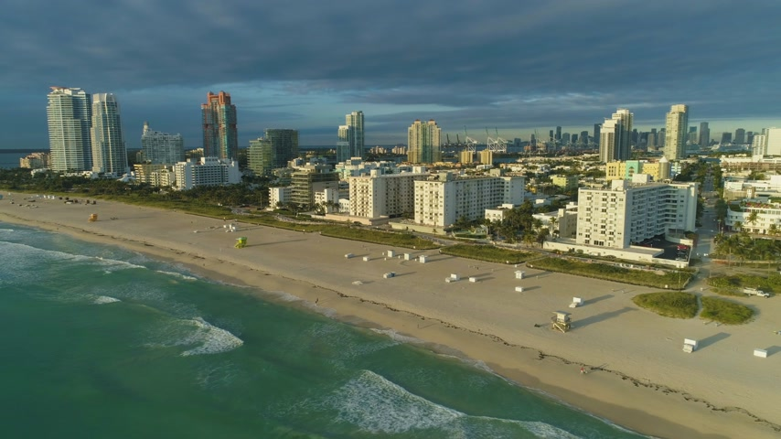 oldalt : South Beach and Miami Downtown at Sunny Morning. Urban Skyline. Ocean Waves. Aerial View. USA