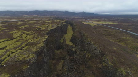 fissures : Fissures and Cracks in Thingvellir National Park in Summer Cloudy Day. Iceland. Aerial View. Reveal Shot