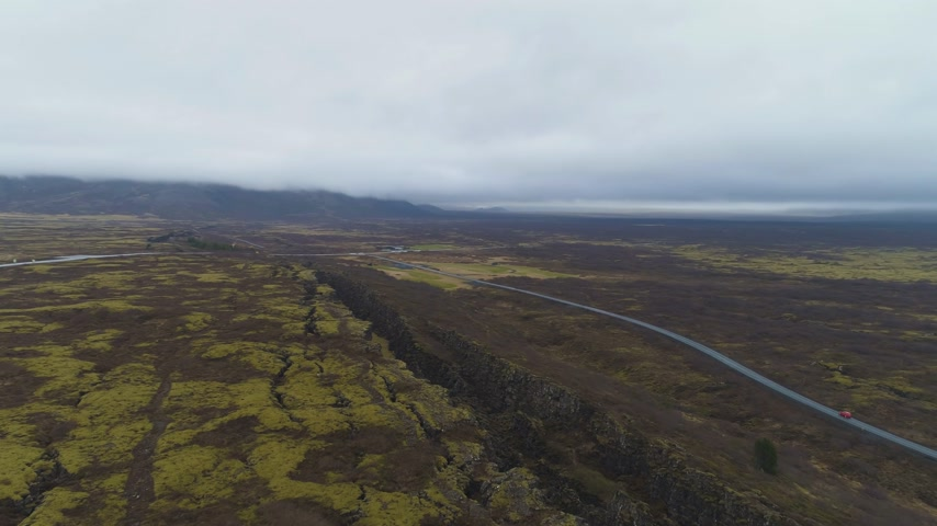 fissures : Fissures and Cracks in Thingvellir National Park. Iceland. Aerial View. Drone is Orbiting