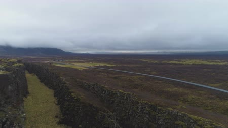 절벽 : Fissures in Thingvellir National Park. Iceland. Aerial View. Drone Flies Backwards