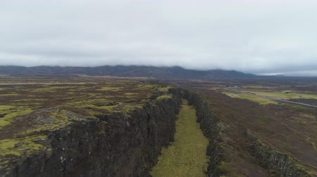 fissures : Fissures in Thingvellir National Park on Summer Day. Iceland. Aerial View. Drone Flies Backwards